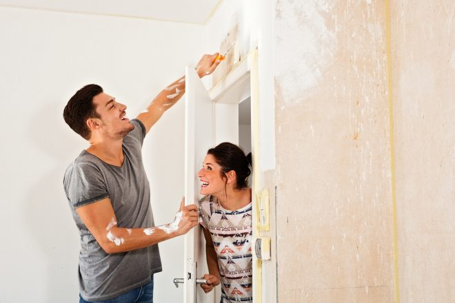 Couple renovating the new dwelling